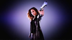 Eliza Dushku Guns & leather Wallpaper